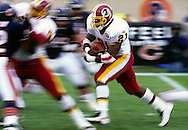 CHICAGO, IL-UNDATED:  NFL running back Terry Allen of the Washington Redskins runs with the ball during a game against the Chicago Bears at Soldier Field in Chicago, Illinois.   Allen played for the Redskins from 1995-1998.  (Photo by Ron Vesely)