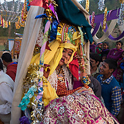 Carried out on the sedan chair. Emotional moment for the bride : she is leaving her childhood home in her village, moving away to her husband's home. Traditional wedding in the Himalaya.