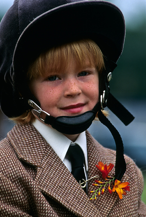 Young horsewoman prepares for her first equestrian competition of the day.