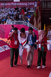 JAKARTA, Aug. 24, 2018  Khalid ALblooshi (2nd L) of the UAE leaves after sustained injury during the Ju-Jitsu Newaza Men's -56 kg Final - Gold Medal competition of the 18th Asian Games in Jakarta, Indonesia, Aug. 24, 2018. (Credit Image: © Zhu Wei/Xinhua via ZUMA Wire)