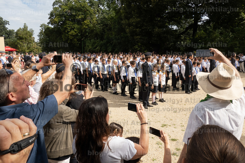 Parents take photos of their children attending the inauguration ceremony of newcomers at the Children's Railway in Budapest, Hungary on Aug. 26, 2020. ATTILA VOLGYI