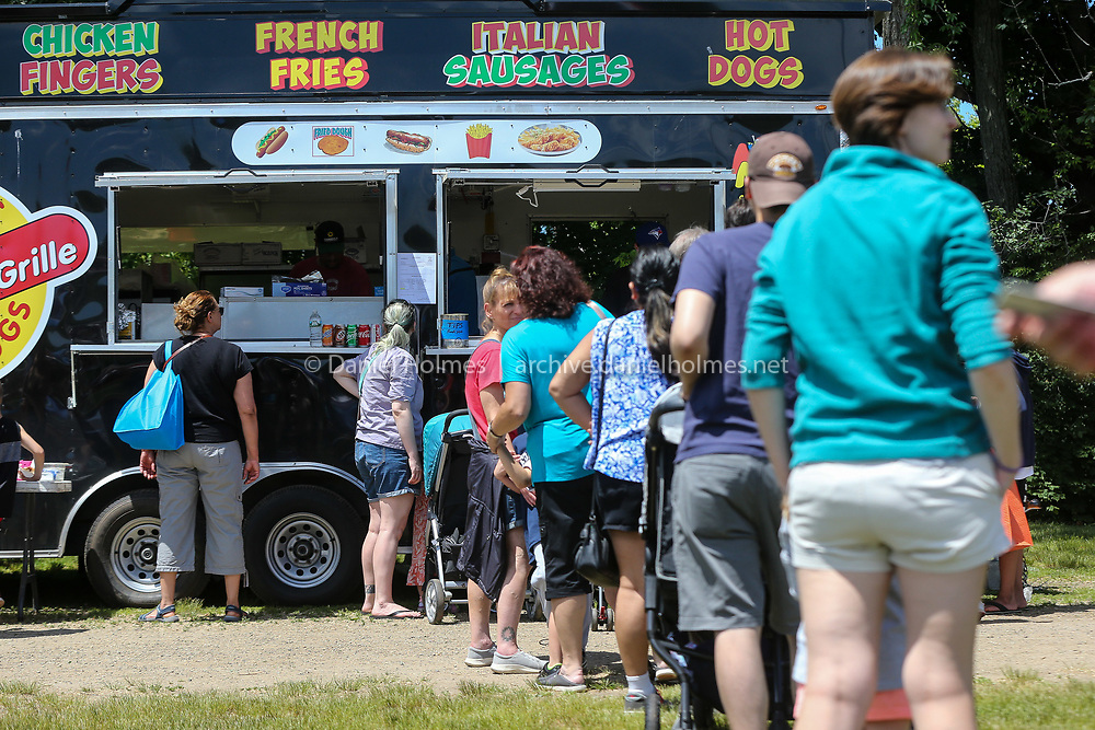(6/15/19, FRAMINGHAM, MA) People wait in line for some grilled food during the 6th annual MetroFest at Bowditch Field in Framingham on Saturday. [Daily News and Wicked Local Photo/Dan Holmes]