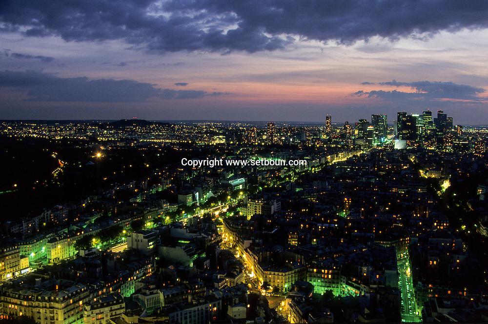 Paris, elevated view of La defense  district at dusk and Neuilly/ . La defense et Neully vue aerienne la nuit