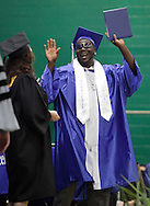 Stefon McGinnis celebrates after getting his diploma during commencement exercises for the Monticello High School class of 2010 at Sullivan County Community College in Loch Sheldrake on Sunday, June 27, 2010.