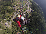 """I stand on the edge of a cliff, overlooking the Isere River, the stone-roofs of Bourg St. Maurice, and hamlets of Les Chapelles, Vulmix, and Seez. My paragliding instructor straps himself to my back and nudges me forward. I'm still not sure if I'm ready for this.<br /> <br /> """"Run,"""" he says. <br /> <br /> I try to move my legs, but then we get tangled and trip over each other, nearly tumbling over the edge. I start to back up and explain why this is not such a good idea.<br /> <br /> """"Run. Don't stop,"""" he says to me again, this time grabbing my shoulders and pushing me forward.<br /> <br /> I close my eyes and keep my legs moving even though there's nothing but the sky beneath my feet."""