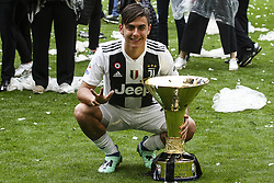May 19, 2018 - Turin, Italy - Juventus forward Paulo Dybala (10) celebrates next to the Serie A soccer title trophy after the Serie A football match n.38 JUVENTUS - VERONA on 19/05/2018 at the Allianz Stadium in Turin, Italy. (Credit Image: © Matteo Bottanelli/NurPhoto via ZUMA Press)