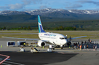 Westjet 737-600 on the ramp unlaoding passensers in Whitehorse, Yukon