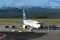 Westjet 737-600 on the ramp unlaoding passensers in Whitehorse, Yukon