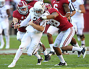 TUSCALOOSA, AL - NOVEMBER 10:  Quarterback Johnny Manziel #2 of the Texas A&M Aggies is tackled by defensive back Vinny Sunseri #3 and defensive back Dee Milliner #28 of the Alabama Crimson Tide during the game at Bryant-Denny Stadium on November 10, 2012 in Tuscaloosa, Alabama.  (Photo by Mike Zarrilli/Getty Images)