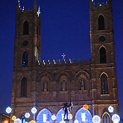 Lights decorate the Place D'Armes in front of the the Basilique Notre-Dame de Montreal.