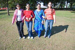 Four friends; walking in the park,