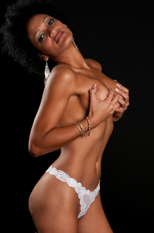 Sensual woman on her thirties very sexy topless in sexy lingerie.