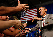 US Democratic presidential candidate Senator Barack Obama (D-IL) greets supporters as he arrives at the town hall at the Rio Grande High School in Albuquerque, New Mexico, August 18, 2008. REUTERS/Jim Young