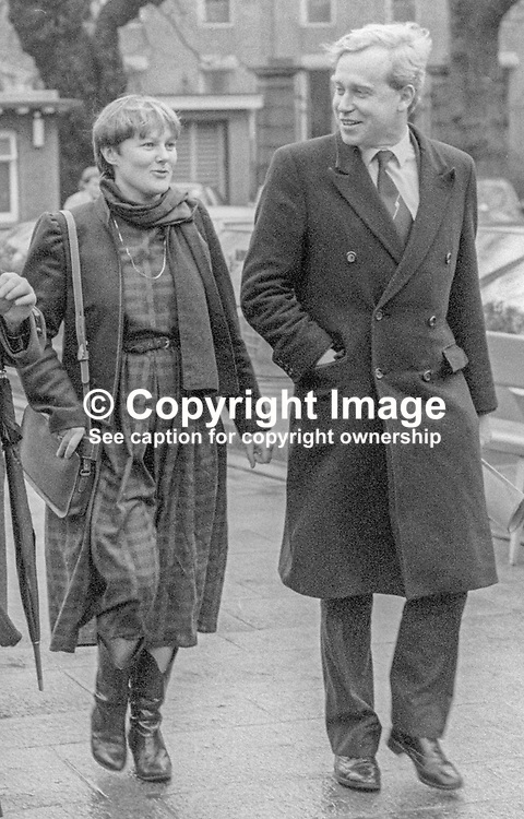 Mary Flaherty, TD, Fine Gael, politician, Rep of Ireland, arriving Leinster House for the opening of the recently-elected Dail Eireann, Irish Parliament, 14th December 1982. She is accompanied by her husband, Alexis Fitzgerald, who failed to win a seat. He was subsequently elected to the Senate. 198212140320MOF+AF. <br /> <br /> Copyright Image from Victor Patterson, Belfast, UK<br /> <br /> t: +44 28 9066 1296 (from Rep of Ireland 048 9066 1296)<br /> m: +44 7802 353836<br /> e: victorpattersonbelfast@gmail.com<br /> <br /> www.images4media.com<br /> <br /> Please see my full Terms and Conditions of Use at https://www.images4media.com/p/terms-conditions - it is IMPORTANT that you familiarise yourself with them.<br /> <br /> Images used online incur an additional cost. This cost should be agreed in writing in advance. Online images must be visibly watermarked i.e. © Victor Patterson or that of the named photographer within the body of the image. The original metadata must not be deleted from images used online.<br /> <br /> This image is only available for the use of the download recipient i.e. television station, newspaper, magazine, book publisher, etc, and must not be passed on to a third party. It is also downloaded on condition that each and every usage is notified within 7 days to victorpattersonbelfast@gmail.com.<br /> <br /> The right of Victor Patterson (or the named photographer) to be identified as the author is asserted in accordance with The Copyright Designs And Patents Act (1988). All moral rights are asserted.
