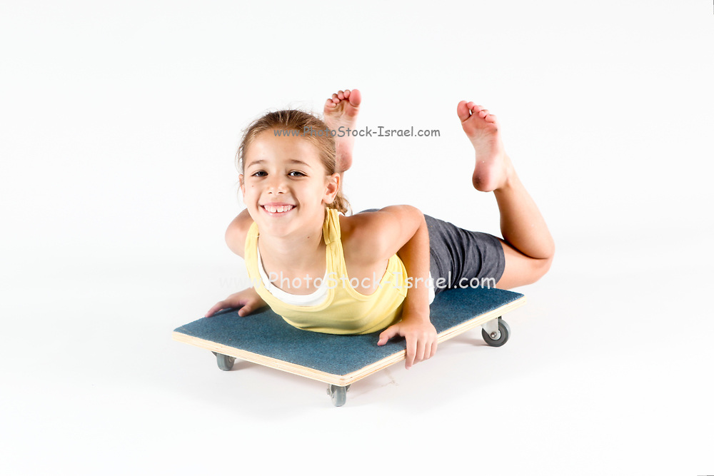 Indoor playground girl plays on wheeled board On white Background