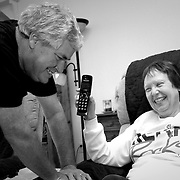 Leo and Sharon smile as they talk to Hadley Wyatt on speakerphone in their home in Skiatook, Oklahoma, Friday, Oct. 14, 2016. Leo asks her questions including whether she'll be at the parade and whether she'll be wearing Oklahoma State orange. Earlier during the call, Hadley's sister, Mia, told the Schmitzes that their pigs are named after current OSU starting quarterback Mason Rudolph and former OSU running back Barry Sanders. The next one will be named after current OSU receiver James Washington. Kurt Steiss/O'Colly