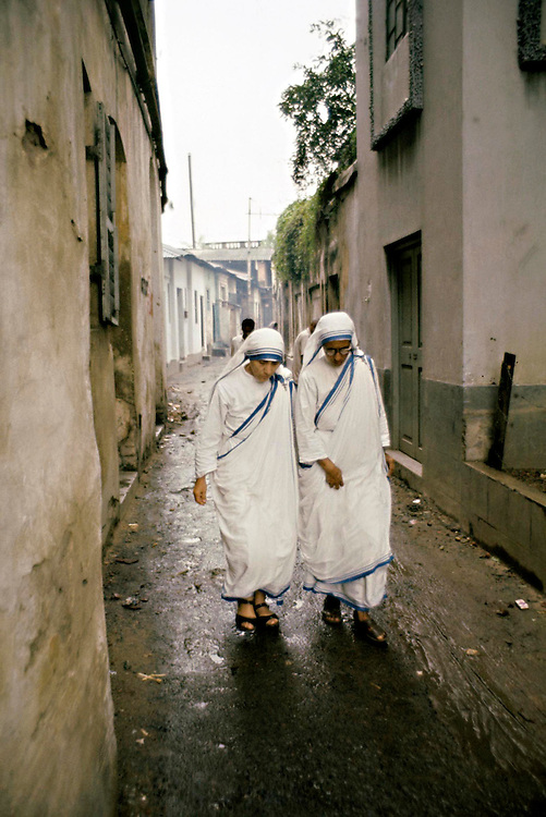 Mother Teresa seen with colleague in the streets of Calcutta, India in 1969.Photographed by Terry Fincher