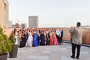 Teacher David Sanford takes a group photo of his senior law enforcement class on the sixth floor balcony as Fairdale High School holds it's prom at the Muhammad Ali Center on Saturday, May 18.