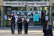 Police is seen outside St Thomas' Hospital in central London as British Prime Minister Boris Johnson is in intensive care fighting the coronavirus in London, Tuesday, April 7, 2020. British Prime Minister Boris Johnson was moved to intensive care after his coronavirus symptoms worsened. Johnson was admitted to St Thomas' hospital in central London on Sunday after his coronavirus symptoms persisted for 10 days. Having been in the hospital for tests and observation, his doctors advised that he be admitted to intensive care on Monday evening.. (Photo/Vudi Xhymshiti)