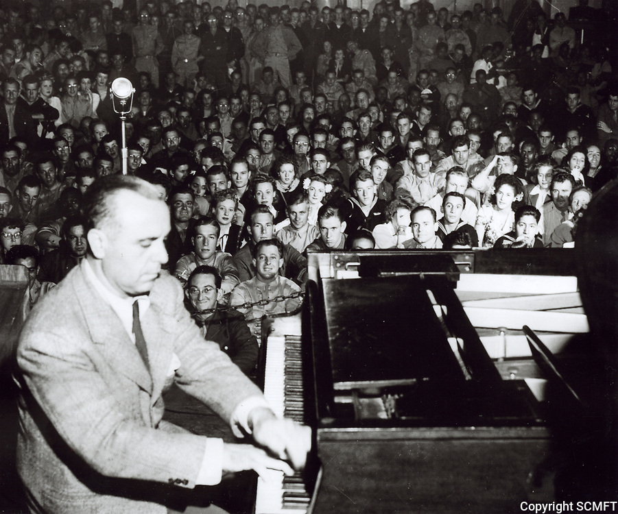 1943 Pianist, Jose Iturbi, entertains the servicemen at the Hollywood Canteen