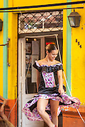 Woman dancing outside, La Boca, Buenos Aires, Argentina, South America