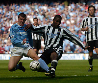 Photo. Glyn Thomas, Digitalsport<br /> NORWAY ONLY<br /> <br /> Manchester City v Newcastle United. <br /> FA Barclaycard Premiership. 01/05/2004.<br /> Newcastle's Titus Bramble halts Richard Dunne's (L) progress.