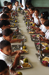 Children eat lunch at one a Bolivarian School, part of Hugp Chavez's plan to reform the country.  Bolivarian Schools are free to the students, offer art and music classes, and also give the children two meals a day.  The school is in session all day, instead of a half day like some elementary schools.