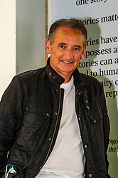Pictured: <br /><br />Pat Nevin dropped into the International Book Festival in Edinburgh today<br /><br />Patrick Kevin Francis Michael Nevin is a Scottish retired footballer. In a 20-year career, he played for Clyde, Chelsea, Everton, Tranmere Rovers, Kilmarnock and Motherwell as a winger. He won 28 caps for Scotland, scattered across a ten-year international career, and was selected for the UEFA Euro 1992 finals squad.<br /><br />Ger Harley | EEm 15 August 2021