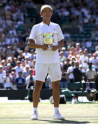 Chun Hsin Tseng with his trophy after winning the Boys' singles final on day thirteen of the Wimbledon Championships at the All England Lawn Tennis and Croquet Club, Wimbledon. PRESS ASSOCIATION Photo. Picture date: Sunday July 15, 2018. See PA story TENNIS Wimbledon. Photo credit should read: Steven Paston/PA Wire. RESTRICTIONS: Editorial use only. No commercial use without prior written consent of the AELTC. Still image use only - no moving images to emulate broadcast. No superimposing or removal of sponsor/ad logos. Call +44 (0)1158 447447 for further information.