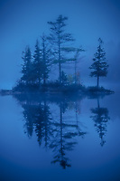 Peaceful, zen like morning reflections on Ricker Pond, Groton State Forest, Vermont