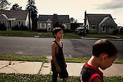 BETHLEHEM, PA – JUNE 14, 2011: Isaiah and Hector Ortiz, ages 6 and 9, toss football with their uncle John Veanus near their home at 430 Grandview in Bethlehem on Tuesday, June 14. Isaiah and Hector are half Puerto Rican.<br /> <br /> As the population of second and third generation Hispanics increases dramatically in the United States, a new boldness can be sensed among Latinos in America, stretching far beyond the southern border states. Demographers in Pennsylvania say the towns of Bethlehem, Allentown and Reading are set to become majority-minority cities, where Hispanics comprise a bigger portion of the population than whites. As this minority population increases dramatically in the region, Latinos are inching closer to their own realization of the American Dream, while gradually shifting the physical and cultural landscapes of their communities.
