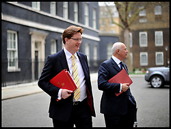 Danny Alexander Chief Secretary to the Treasury and Iain Duncan Smith leave No10 Downing after the Budget Cabinet meeting and just before The Chancellor George Osborne poses on the steps of No11 Downing street with his red budget box for the 2014 Budget, London, United Kingdom. Wednesday, 19th March 2014. Picture by Andrew Parsons / i-Images