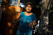 2016/10/10 – Bahia de Caráquez, Ecuador: Narcisa Mera, 53, leaving her improvised kitchen in  Sucre Park, the central square in Bahia de Caráquez, Ecuador, 10th October 2016. Narcisa refuses to move to a shelter provided by the Government, because she is afraid that thieves can steal the few belongings she possesses. She claims that shelters are filled with some bad people and she can't protect her things and her grandchildren. Instead, she prefers to live in the Park in front of her former house that was destroyed by the 16th April earthquake with another 30 families. (Eduardo Leal)