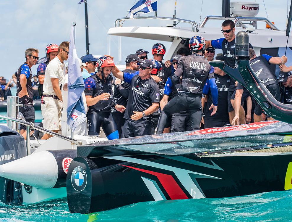 Grant Dalton, CEO<br /> Emirates Team New Zealand<br /> patting the helmet of Blair Tuke<br /> <br /> Day  5<br /> 2017 35th America's Cup Bermuda