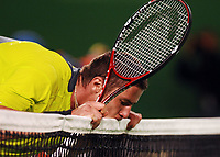 Australian Open Tennis Melbourne 15/01/2007<br /> Marat Safin (RUS) bites net during  first round five set victory<br /> Photo Roger Parker Fotosports International