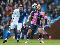 Blackburn Rovers' Joe Rothwell (left) and Coventry City's Liam Kelly battle for the ball during the Sky Bet Championship match at Ewood Park, Blackburn. Picture date: Saturday October 16, 2021.