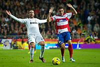 20120107: MADRID, SPAIN - BBVA League: Football macht between Real Madrid C.F vs Granada in Santiago Bernabeu, Madrid, Spain.<br /> In photo: Gonzalo Higuain(L) in action.<br /> PHOTO: CITYFILES