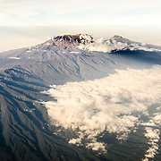 Mount Kilimanjaro Aerial View Summit with Snow. An aerial view of Mount Kilimanjaro, the highest peak in Africa, with a snow-covered peak.