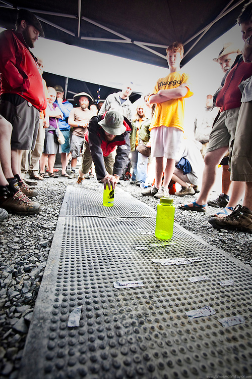 Hikers gather to watch the competitors in the Nalgene Olympics.  Comptetitors strive for the top three positions in order to take home a Princeton Tech Head Lamp.