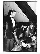 David Koch and dancer. New year's eve party. Aspen. 1 Jan 1995. © Copyright Photograph by Dafydd Jones 66 Stockwell Park Rd. London SW9 0DA Tel 020 7733 0108 www.dafjones.com