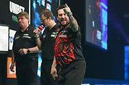 Jonny Clayton hits the winning double to reach the final and celebrates during the PDC Unibet Premier League darts at Marshall Arena, Milton Keynes, United Kingdom on 28 May 2021.