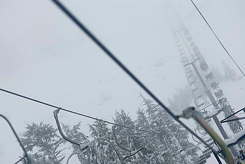 Unknown people riding chairlift at Kirkwood ski resort near Lake Tahoe, CA.