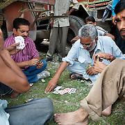 Truck drivers play cards at a truck depot outside of Haridwar, Uttarkand, September 2009