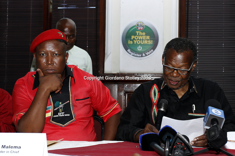DURBAN - 20 January 2014 - EFF leader Julius Malema looks on as Inkatha Freedom party leader Mangosuthu Buthelezi reads a statement at a joint press conference where Malema apologised for remarks made when he was ANC Youth League president. Picture: Allied Picture Press/APP