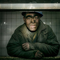 A miner just returned from working the coalface at the Jin Hua Gong Coal Mine, Shanxi Province, China. Seventy percent of China's energy comes from coal.