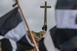 © Licensed to London News Pictures. 05/03/2017. PERRANPORTH, CORNWALL, UK.  St Piran. St. Piran's Day in Cornwall. St Piran is the patron Saint of Sinners in Cornwall and it is his flag that is recognised as the Cornish flag. Today his arrival from Ireland to Cornwall is celebrated across Cornwall especially in Perranporth where it is believed that he landed. He set up an Oratory and a Church the remains of which have been recently uncovered in the sand dunes at Perranporth..  Photo credit: MARK HEMSWORTH/LNP