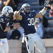 Yale running back Tyler Varga, (right), is congratulated by quarterback Morgan Roberts after scoring a touchdown during the Yale Vs Princeton, Ivy League College Football match at Yale Bowl, New Haven, Connecticut, USA. 15th November 2014. Photo Tim Clayton
