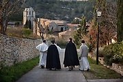 Priests from the Abbey of Lagrasse having a post Christmas stroll, 27th December 2016, Lagrasse France. The Abbey of St. Mary of Lagrasse is a Romanesque abbey in Lagrasse, southern France. The priests, live in common under the Rule of St. Augustine, and dedicate their lives to the liturgy, which they celebrate in the pre-Vatican II form, and to evangelization. Common life, contemplative life, and apostolic life form the three facets of their charism.