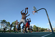 Players take part in a pickup basketball game on a court at Osprey Park in the Hunter's Creek neighborhood in Orlando, Fla., Monday, Aug. 22, 2016. (Phelan M. Ebenhack via AP)