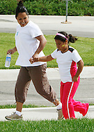 Fernanda Garcia-Villanueva, 8, runs with her mother Areli Villanueva in the annual run/walk for patients and their friends and families at The Children's Hospital in Aurora, Colorado June 5, 2010.  The run/walk is for patients in the various weight management programs at the hospital. REUTERS/Rick Wilking (UNITED STATES)